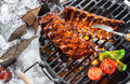 Spare ribs grilling over a winter BBQ Royalty Free Stock Photo