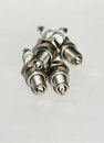 Spark plugs on white paper Stock Images