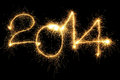 Sparking year new formed from digits over black background Stock Photo