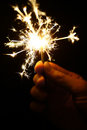 Sparkler color shot of a hand holding a Royalty Free Stock Photos