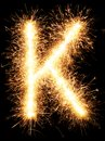 Sparkler firework light alphabet K on black Royalty Free Stock Photo