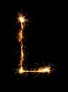 Sparkler firework light alphabet L (Capital Letters) at night Royalty Free Stock Photo