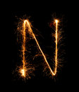 Sparkler firework light alphabet N (Capital Letters) at night Royalty Free Stock Photo