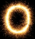 Sparkler firework light alphabet O on black Royalty Free Stock Photo