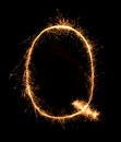 Sparkler firework light alphabet Q (Capital Letters) at night Royalty Free Stock Photo