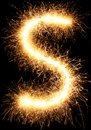 Sparkler firework light alphabet S on black Royalty Free Stock Photo