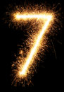 Sparkler firework light number 7 isolated on black Royalty Free Stock Photo