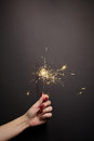Sparkler in woman hand with red nail polish Royalty Free Stock Photo