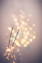 Sparklers and bokeh Royalty Free Stock Photo