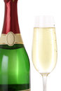 Sparkling champagne in a glass and bottle isolated on white background Stock Photo