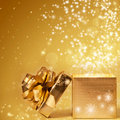 Sparkling christmas background with opened gift box golden Royalty Free Stock Image