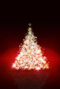 Sparkling christmas tree background with defocused lights Royalty Free Stock Image
