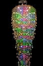 Sparkling colorful chandelier sparking suspended from ceiling Stock Images
