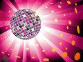Sparkling disco ball on magenta light burst Stock Photo