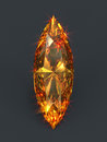 Sparkling orange gem marquise shape precious gemstone shining with deep ember glares and burning fire cat eye shaped color diamond Royalty Free Stock Photo