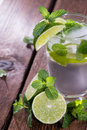 Sparkling water mint and lime on wooden background Stock Image