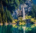Sparkling waterfall on the Oeschinensee Lake. Splendid summer morning in the Swiss Alps, Kandersteg village location, Switzerland, Royalty Free Stock Photo