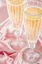 Sparkling wine on pink satin background two glasses of champange or Royalty Free Stock Image