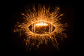 Sparkly american football on dark background with copy space Stock Photo