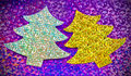 Sparkly christmas trees closeup of two cardboard cutout with glittery purple background Royalty Free Stock Photography