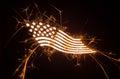 Sparkly curvy flag on dark background Stock Photo