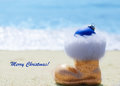 Sparkly glitter boot by the ocean with christmas ball Royalty Free Stock Photos