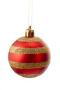 Sparkly gold and red striped christmas ball isolated on white Royalty Free Stock Photo