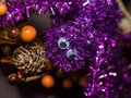 Sparkly spider purple decoration hanging on a door during halloween Royalty Free Stock Photo