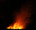 Sparks and embers flying off a bonfire Royalty Free Stock Photos