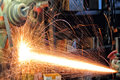Sparks of fire arising in the process metal cutting Royalty Free Stock Photos