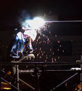 Sparks fly from night welding Royalty Free Stock Photo