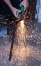 Sparks while grinding worker cutting metal using angular machine Stock Images
