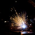 Sparks during metal cutting over black Royalty Free Stock Image