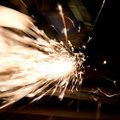 Sparks during metal cutting over black Royalty Free Stock Photos