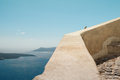 Sparrow on the parapet beautiful landscape with sea view santorini island greece selective focus Royalty Free Stock Photography