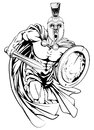 Spartan man running an illustration of a warrior character or sports mascot in a trojan or style helmet holding a sword and shield Royalty Free Stock Image