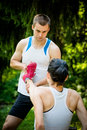 Spasm when sport hurts man helps women with muscle stretching her leg Stock Photography