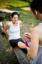 Spasm when sport hurts man helps women with muscle stretching her leg Royalty Free Stock Photos