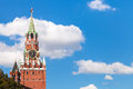 Spasskaya tower of moscow kremlin and blue sky clock white clouds in in sunny summer day Stock Photos