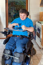 Spastic young man confined to a wheelchair multifunctional as result of infantile cerebral palsy caused by birth complications Royalty Free Stock Photo