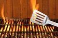 Spatula Close-up On The Hot Flaming BBQ Grill Royalty Free Stock Photo