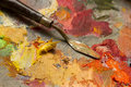 Spatula on a palette with oil paints