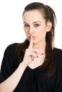 Speak no evil attractive young brunette black dress finger her lips isolated white background Stock Photo