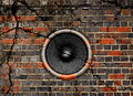 Speaker on a cracked brick wall background Stock Images