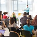 Speaker giving presentation on business conference. Royalty Free Stock Photo