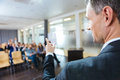 Speaker pointing to audience on business conference Royalty Free Stock Photo
