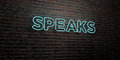 SPEAKS -Realistic Neon Sign on Brick Wall background - 3D rendered royalty free stock image
