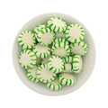 Spearmint starlight mints in a small bowl Royalty Free Stock Photo