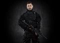 Spec ops police officer SWAT in black uniform studio Royalty Free Stock Photo