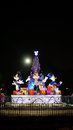 A special christmas tree in hong kong disneyland surrounded by the statues of mickey and minnie mouse and donald duck Stock Images
